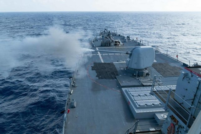 The Arleigh Burke-class guided-missile destroyer USS Curtis Wilbur, shown here conducting a live fire gunnery exercise in 2016, transited the Taiwan Strait on Wednesday. Photo by Jonathan Peterson/U.S. Navy