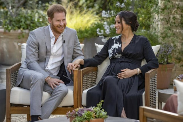 Prince Harry and Meghan Markle speak with Oprah Winfrey in an interview on CBS News Sunday. Photo by Joe Pugliese/Harpo Productions