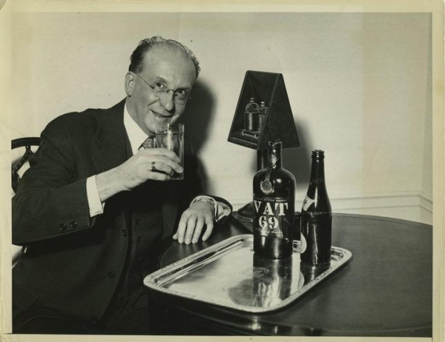 Benjamin De Casseres poses with his highball awaiting word of Prohibition's repeal via a cable set up by the United Press at the Waldorf-Astoria in New York, Dec. 6, 1933. File photo by United Press/public domain