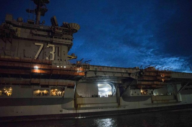 The Nimitz-class aircraft carrier USS George Washington is pictured in transit to Newport News, Va., for overhaul. U.S. Navy photo by petty Officer 3rd Class Alora Blosch