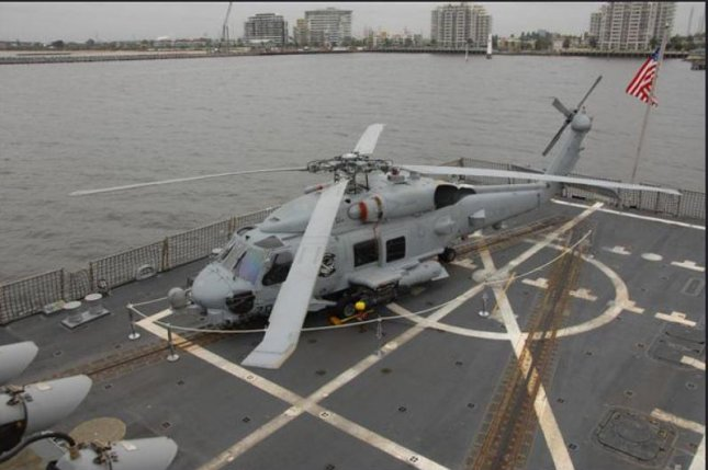 An MH-60R helicopter is aboard the USS Shoup in Port Phillip Bay, Melbourne, Australia at the 2011 Avalon Airshow. Photo courtesy Lockheed Martin/Flickr