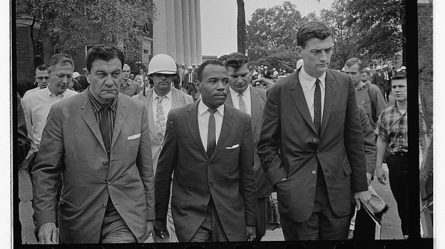 Integration at University of Mississippi--James Meredith accompanied to class by U.S. marshals at Oxford, Mississippi, October 1, 1962. (Marion S. Trikosko/Library of Congress)