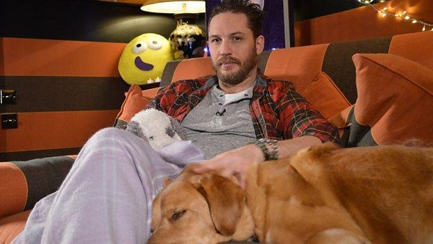 Actor Tom Hardy will read a CBeebies bedtime story to young viewers on New Year's Eve. Photo of Hardy and his dog Woodstock courtesy of the BBC