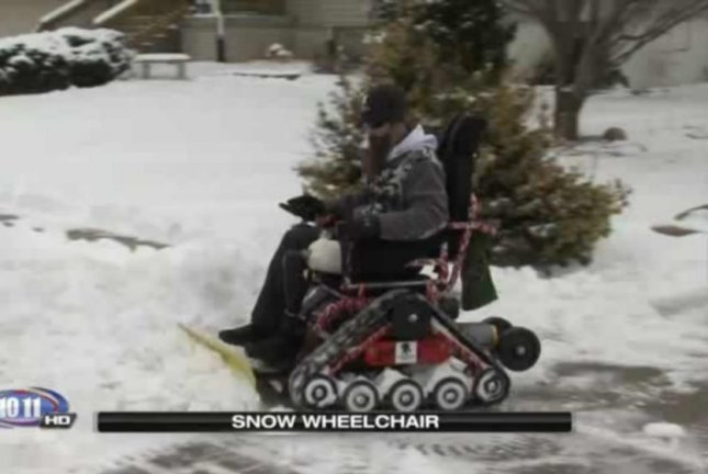Justin Anderson uses his wheelchair to plow the sidewalks of Bellevue, Neb. KOLN-TV video screenshot