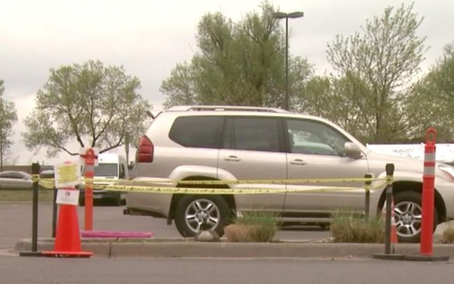 Employees at a Whole Foods Market in Colorado have set up a barricade to protect a mother goose who decided to lay her eggs in the parking lot. Screen capture/CBS Denver/AOL
