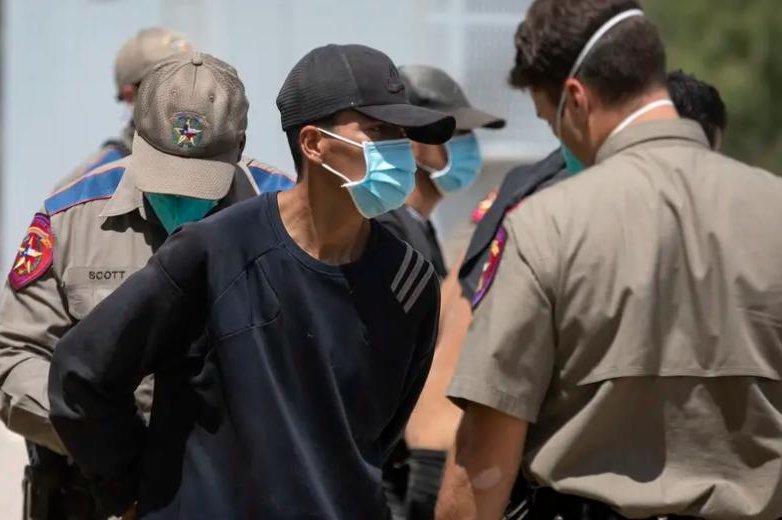 Migrants arrested in Texas border crackdown imprisoned for weeks