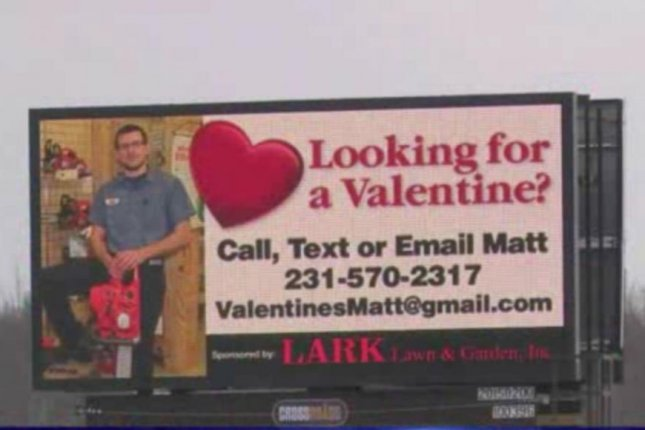A Michigan man's coworkers secretly took out a billboard personal ad to find him a Valentine. Screenshot: WILX-TV