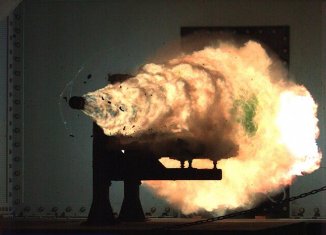 A new energy module designed for the U.S. Navy's experimental Railgun, pictured as it is being fired, powers the weapon using electro-magnetic energy, rather than explosives or a propellant. U.S. Navy photograph
