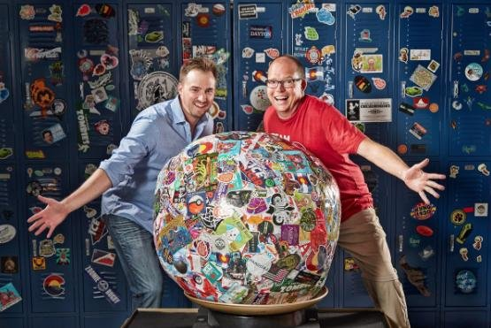 John Fischer (L) has made the world's largest sticker ball by using around 200,000 stickers. Photo courtesy of Guinness World Records/Twitter