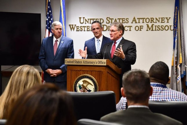 U.S. Marshal Mark James (R), with Missouri Gov. Mike Parson (L) and U.S. Attorney Tim Garrison, announces the results of Operation Triple Beam, a 10-week mission to remove violent criminals for Kansas City's streets. Photo courtesy of Missouri Gov. Mike Parson/Facebook