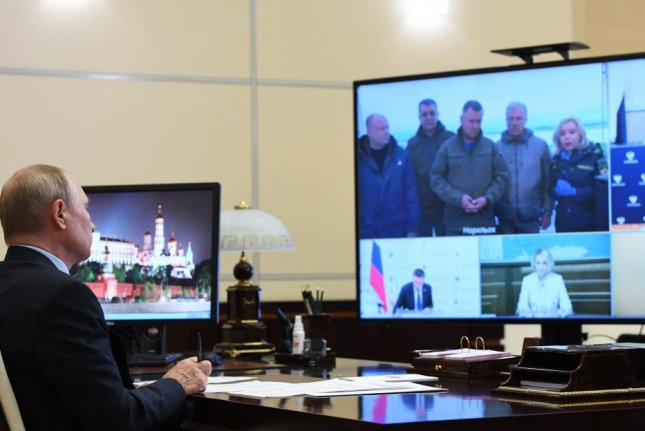 Russian President Vladimir Putin attends a virtual meeting near Moscow on the remedial action after the diesel fuel spill in Norilsk on June 19. A second spill in the Arctic Sunday caused officials there to call a state of emergency. Photo by Alexei Nikolsky/EPA-EFE