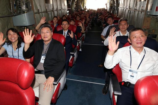 South Korea's basketball delegation members wave as they leave for Pyongyang aboard a military plane on July 3, 2018, from an airport in Seongnam, south of Seoul. The two Koreas will hold a set of four friendly matches over two days with mixed teams of players from the two sides. This is the fourth such event, and the first since October 2003. Photo by Yonhap