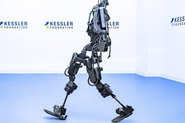 Exoskeletons can improve mobility in people paralyzed with spinal cord injuries, a new study found. Photo by Kessler Foundation/HealthDay