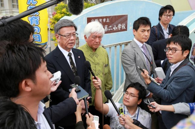Okinawa governor Takeshi Onaga speaks to reporters at the Daini Futenma Elementary School in Okinawa on Dec. 13 where the window of a U.S. military helicopter fell. Photo by Hitoshi Maeshiro/EPA-EFE