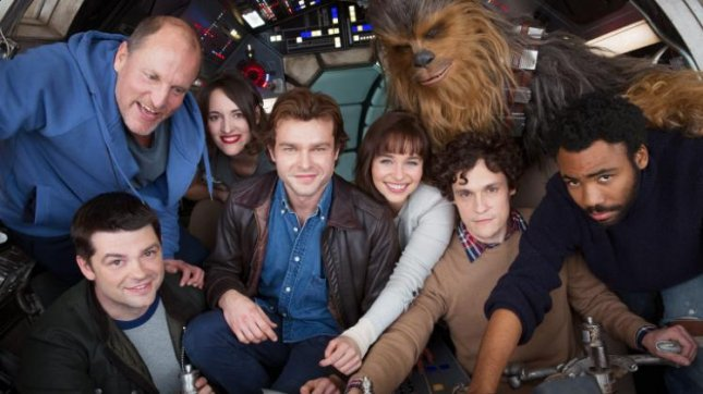 The cast and crew of Disney's upcoming Han Solo spinoff film including (L-R) Woody Harrelson, Phoebe Waller-Bridge, Alden Ehrenreich, Emilia Clarke, Joonas Suotamo as Chewbacca, Donald Glover with directors Phil Lord and Chris Miller out front. Production has now begun on the Star Wars prequel. Photo courtesy of StarWars.com