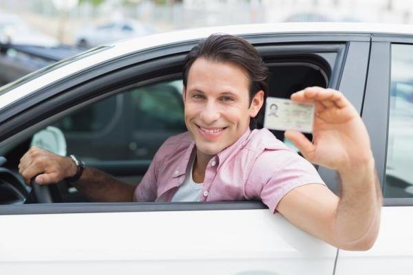 The Virginia Department of Motor Vehicles repealed a rule that prohibited patrons from smiling with teeth in their license and ID photos. Photo by wavebreakmedia/Shutterstock