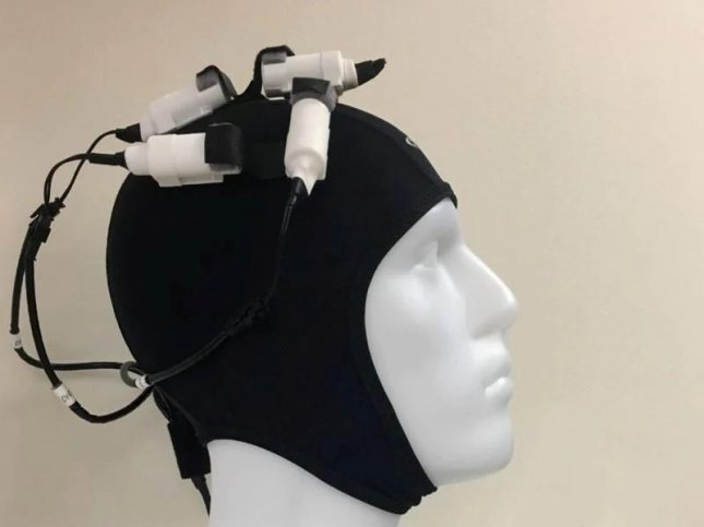 Researchers say that a device controlled with a smartphone that looks like a swim cap -- with multiple magnetic microstimulators attached -- may help increase motor function in people who have had a stroke. Photo by Blessy John/HealthDay News