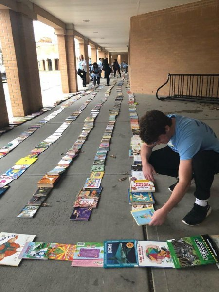 A New York state nonprofit broke a Guinness World Record by creating a line of books measuring 3.81 miles long. Photo courtesy of The Book Fairies