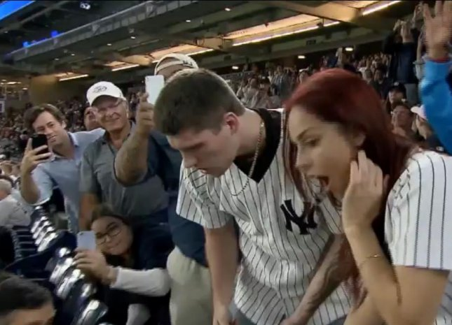 A couple's Yankee game proposal quickly became a disaster as the ring disappeared inside the crowded stadium. Fans helped search and the story had a happy ending as the ring was found and the couple were engaged. 
