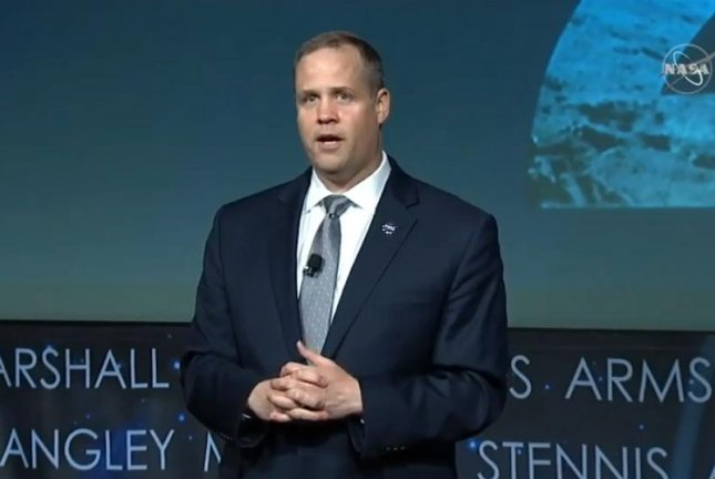 NASA Administrator Jim Bridenstine speaks Tuesday at a town hall meeting with agency employees about a proposed moon landing in 2024. Photo courtesy of NASA