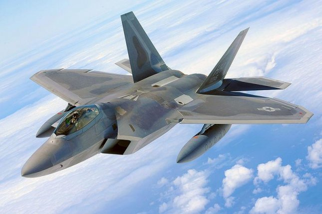 Airmen spent two days identifying a solution for an F-22's weapon system malfunction. Photo by U.S. Air Force