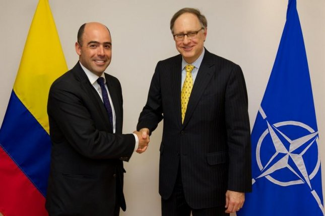 NATO Deputy Secretary General Alexander Vershbow (R) meets with Colombian Vice Minister of Defense Jorge Enrique Bedoya in this 2014 photo. Colombia said Friday it would begin cooperation talks with NATO, an announcement that angered neighboring Venezuela. File Photo courtesy of NATO