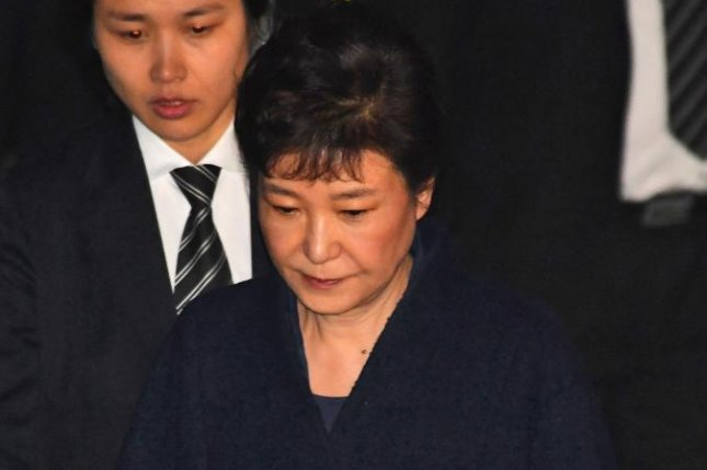 Ousted South Korean President Park Geun-hye leaves after a hearing at the Seoul Central District Court on March 30. Park's arrest on Friday was covered in North Korea state media. Photo courtesy of Song Kyung-seok/Pool/EPA