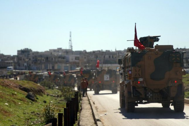 Turkish forces move in the de-escalation zone in Idlib province Friday as part of a peace deal with Russia in the Syrian rebel stronghold. Photo by Yahya Nemah/EPA-EFE