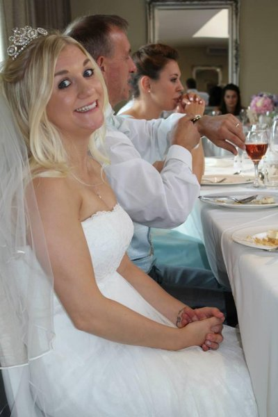Samantha Wragg wrote a tongue in cheek eBay listing poking fun at her cheating scumbag of a husband to help sell her wedding dress. Wragg said she hoped to sell the dress which her parents bought for $2,615 U.S. in 2014 to pay for her divorce.  Photo by Smantha Wragg/eBay