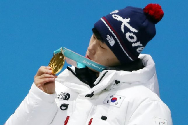 South Korea's Yun Sung-bin looks at the gold medal he won in the men's skeleton on Friday at the Pyeongchang Winter Olympics during the medals ceremony in PyeongChang, east of Seoul. Yun won South Korea's second gold of the Games and its first-ever Olympic gold outside of skating events. He also became the first Asian to win a medal in Olympic skeleton. Photo courtesy of Yonhap