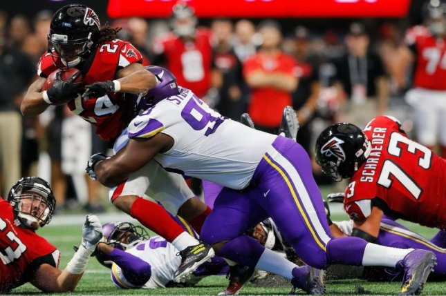 Former Vikings defensive tackle Shamar Stephen makes a tackle on Atlanta Falcons running back Devonta Freeman (24). The Seattle Seahawks announced Saturday that they signed Stephen to a contract. Photo courtesy of Minnesota Vikings/Twitter