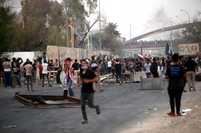 Iraqi protesters gather outside a government building in Basra, Iraq, on Wednesday. Protests against corruption and poor government services have swept most of the Iraqi southern provinces since June. Photo by Haider Al-Assadee/EPA-EFE