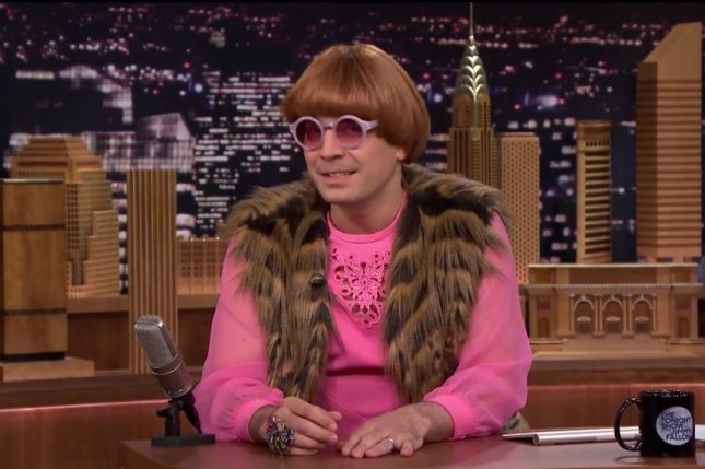 Jimmy Fallon succumbed to Charlize Theron's fashion choices on The Tonight Show Monday night. Photo by The Tonight Show/NBC