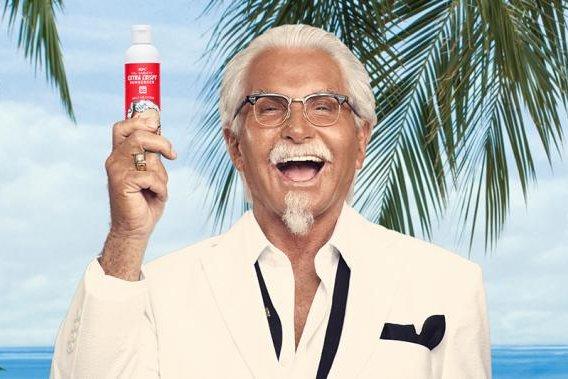 Colonel Sanders (George Hamilton) shows off a bottle of KFC Col. Sanders' Extra Crispy Sunscreen. Photo courtesy of KFC