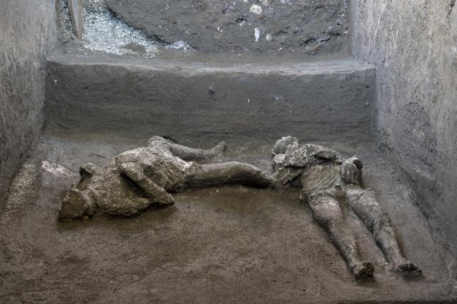 A photo made available by Parco Archeologico of Pompeii shows two bodies, master and slave: they are the almost intact bodies of two men in Pompeii, Italy, 21 November 2020. Luigi Spina /Parco Archeologico / EPA-EFE