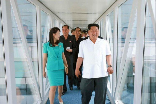 North Korean leader Kim Jong Un tours the new terminal at Pyongyang's Sunan Airport with spouse First Lady Ri Sol Ju in July. Kim is seeking improved relations with Beijing, according to China's state media. File Photo by Rodong Sinmun/Yonhap