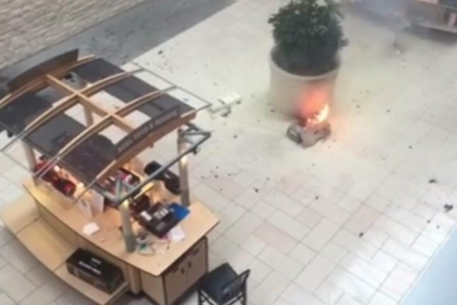 A hoverboard self-balancing scooter caught fire and exploded at the Deerbrook Mall in Houston. New York Daily News video screenshot