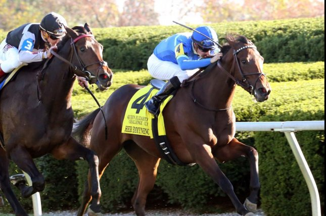 Her Emmynency (4) wins the QE II Challenge Cup at Keeneland Saturday over Miss Temple City. (Keeneland photo)