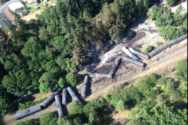 A 95-car Union Pacific train carrying crude oil to Tacoma, Wash. has derailed, prompting a blazing fire in two cars and a nearby evacuation. Photo by WA Department of Ecology/Twitter