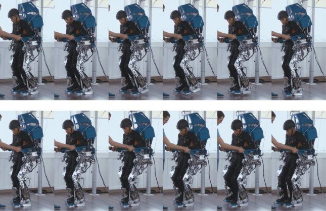 A patient uses the Walk Again Project's exoskeleton after training with a virtual reality environment and a device to help relearn the motions of walking. Photo by Alberto Santos Dumont Association for Research Support
