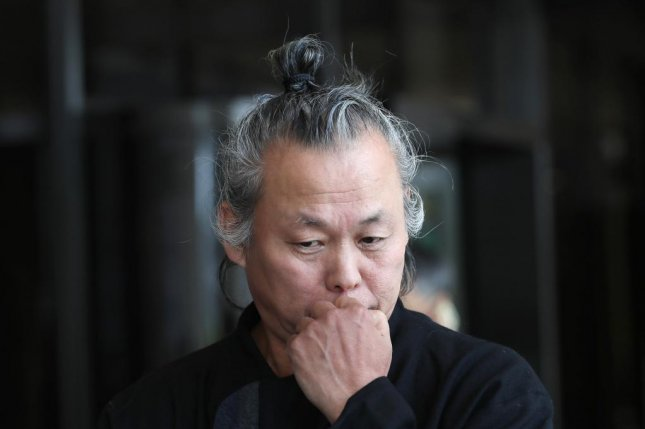 Filmmaker Kim Ki-duk appears at the Seoul Central District Prosecutors' Office on June 12, over allegations that he sexually abused women. Photo by Yonhap