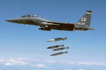 Several 500-pound bombs equipped with Joint Direct Attack Munition Global Positioning System guidance kits are released from an F-15 aircraft during testing. Photo courtesy of Boeing