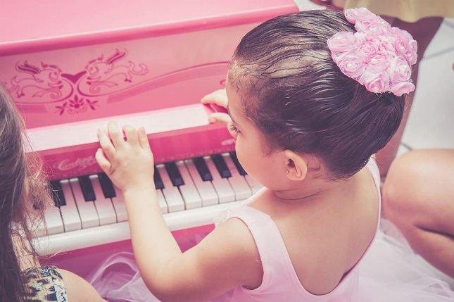New research suggests a third of 6-month-olds can differentiate between major and minor music notes. Photo by Pxfuel/CC