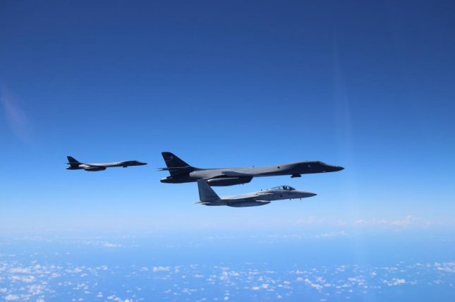 B-1B Lancers, which are expected to start carrying the Long Range Anti-ship Missile next year, are pictured flying with Japanese F-15s. U.S. Air Force photo