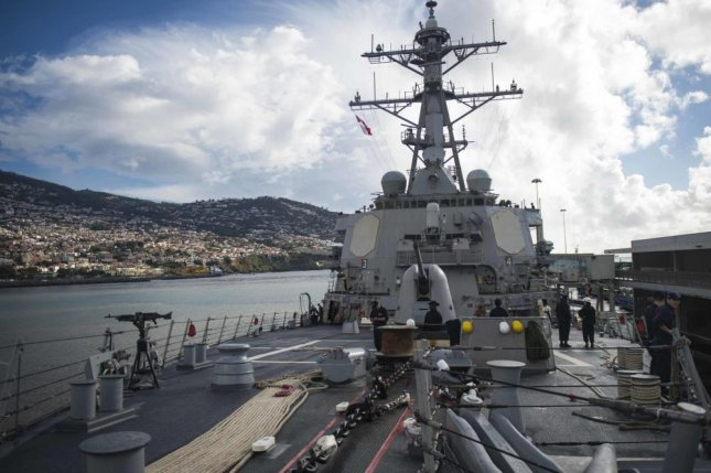 The guided-missile destroyer USS Stout, pictured, while moored in Funchal, Portugal, for refueling. Photo by Petty Officer 3rd Class Bill Dodge/U.S. Navy