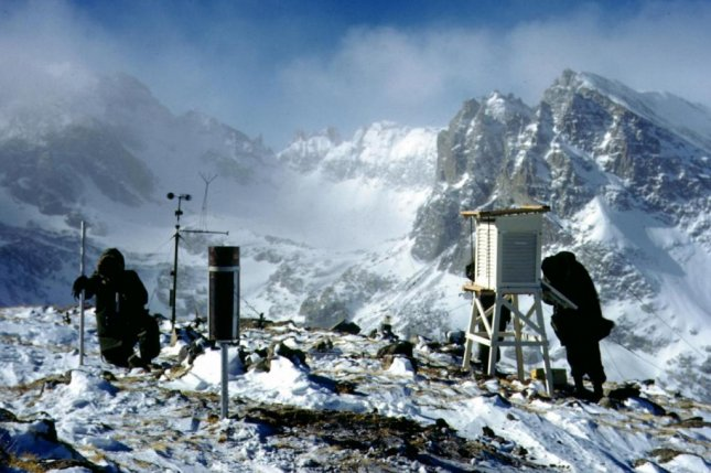 Researchers measure snow and ice conditions high in the Rockies. Photo by University of Colorado