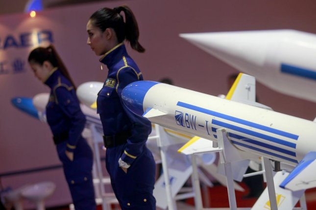Models pose next to BW-I missile models, on display at the International Air Show in Zhuhai, China, where a Chinese firm that recently tested a supersonic cruise missile will be participating in November. File Photo by Diego Azubel/EPA