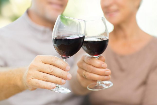 Researches think the social aspect of drinking may partially contribute to the benefits of moderate alcohol consumption among early Alzheimer's patients. Photo by Syda Productions/Shutterstock