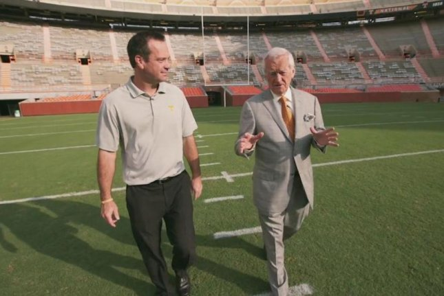 John Ward (R), known as the Voice of the Vols at the University of Tennessee, has died after a lengthy illness at the age of 88. Photo courtesy of Tennessee Vols Football/Twitter