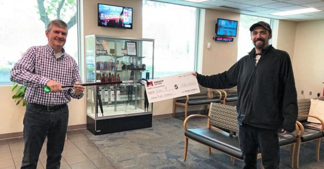 An Oregon man said staying up all night to help his wife left him with a need for caffeine, and led him to a $100,000 lottery prize. Photo courtesy of the Oregon Lottery
